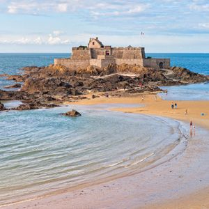 Tidal beach and medieval castle Petit Be Saint Malo, Brittany